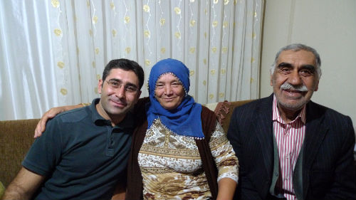 Ali with his mother and father