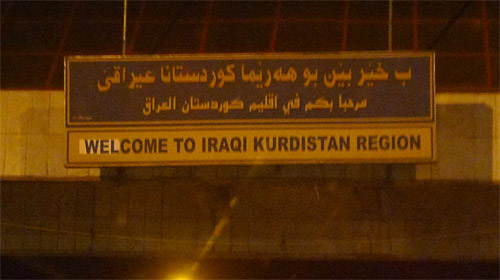 "A sign saying ""Welcome to Iraqi Kurdistan region"""